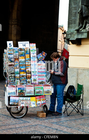Man selling postcards and guidebooks in Prague, Czech Republic - Stock Photo