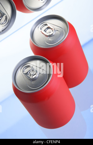 Red drink cans close up in fridge - Stock Photo