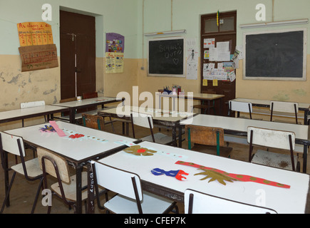 desks in rows in an empty classroom stock photo royalty free image