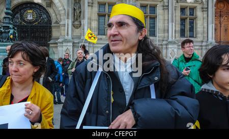 Paris, France, Anti Nuclear Power Activists Demonstrating on Anniversary of Fukushima Disaster, Portrait Senior - Stock Photo