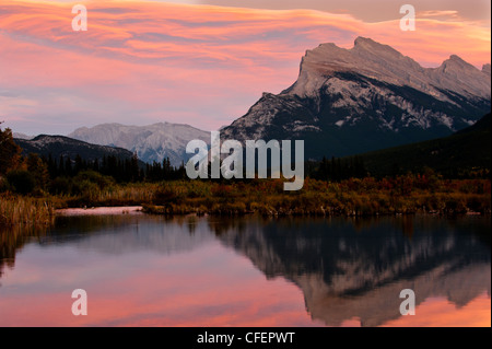 Evening clouds over Mount Rundle outside of Banff, Alberta, Canada. - Stock Photo