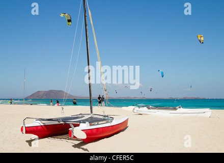 Kitesurfing from Flag beach, Corralejo with Lobos island in background. Fuerteventura, Canary Islands, Spain - Stock Photo