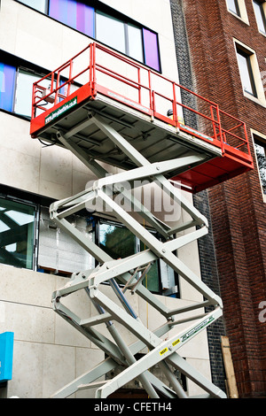 Mobile elevating work platform in use on external building refurbishment, - Stock Photo