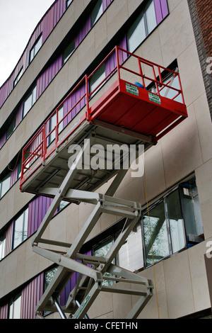 Mobile elevating work platform in use on external building refurbishment, - Stock Photo