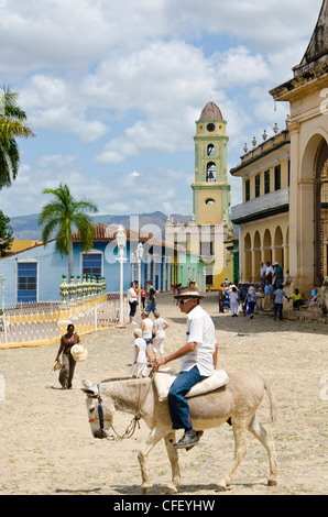 Old man on a donkey, Trinidad, UNESCO World Heritage Site, Cuba, West Indies, Caribbean, Central America - Stock Photo