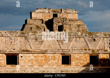 The Nunnery Quadrangle with the Pyramid of the Magician in the background, Uxmal, UNESCO World Heritage Site, Yucatan, - Stock Photo
