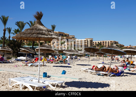 Beach scene in the tourist zone of Sousse, Gulf of Hammamet, Tunisia, North Africa, Africa - Stock Photo