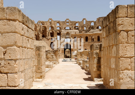 El Jem. Tunisia. Partial view of the elliptical arena and interior of the magnificent honey coloured ancient Roman - Stock Photo