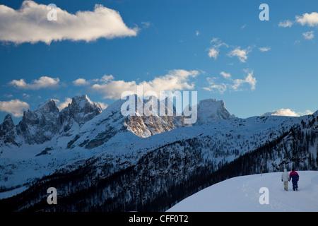 Winter walk around San Pellegrino pass, Pale di San Martino range in the background, Dolomites, Alps, Trentino Alto - Stock Photo