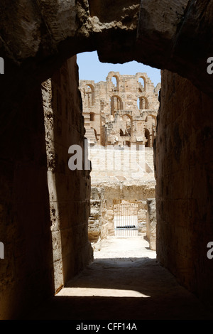 Through an archway of the elliptical arena and interior of the magnificent honey coloured ancient Roman amphitheatre - Stock Photo