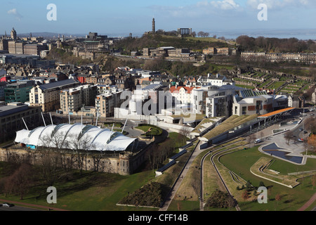 The Scottish Parliament stands in the foreground, under Calton Hill, in Edinburgh, Scotland, United Kingdom, Europe - Stock Photo