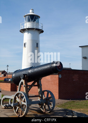 Lighthouse and old Russian Cannon a captured trophy from the Crimean War presented to Hartlepool in 1857 - Stock Photo