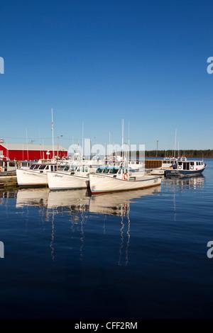 Fishing boat tied up at wharf, Northport, Prince Edward Island, Canada - Stock Photo