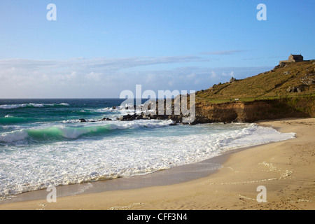 Surf in sea off Porthmeor beach in evening sun, St. Nicholas chapel on the island, St. Ives, Cornwall, England, - Stock Photo