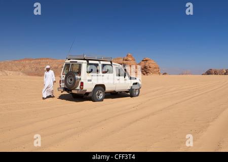 Jeep safari in the Sinai desert with bedouin driver, Egypt. - Stock Photo