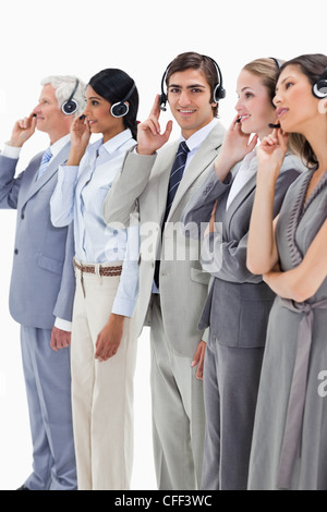 Professionals in suits listening - Stock Photo