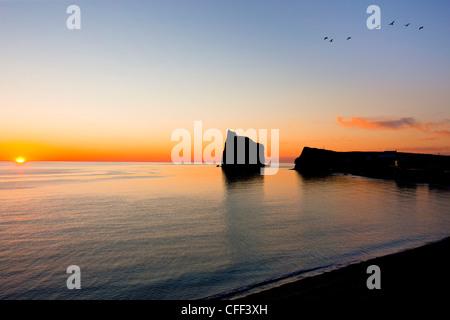 Perce Rock at sunrise, Perce, Gaspé Penninsula, Quebec, Canada - Stock Photo