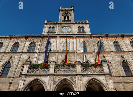 View of the fassade with flaggs, Town Hall, Weimar, Turingia, Germany - Stock Photo