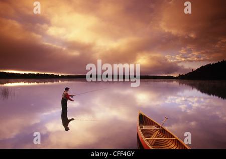 fly fishing on 108 Mile Lake, British Columbia, Canada. - Stock Photo