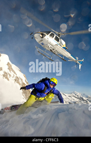 Helicopter and skier in the mountains, South Tyrol, Italy, Europe - Stock Photo