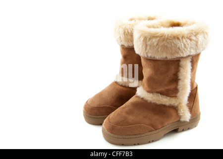 Fluffy woolly warm boots isolated over white - Stock Photo