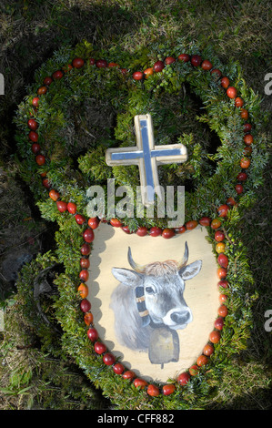 Handcrafted decoration used at ceremonial driving down of cattle from the mountain pastures, Val D'Ultimo, South - Stock Photo
