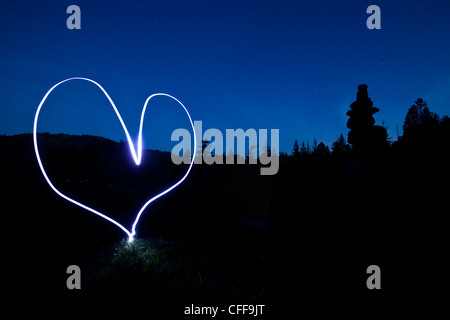 A light painting of a heart at sunset in Idaho.