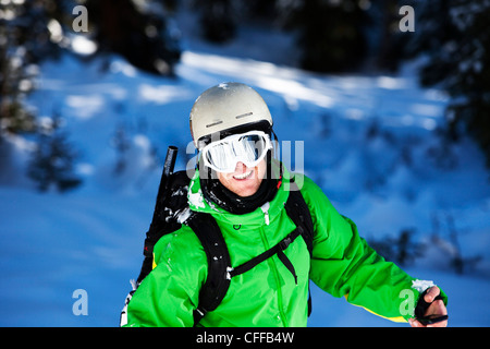 A happy skier smiles after skiing fresh powder in Colorado. - Stock Photo
