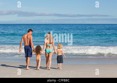 Family spending their time on the beach - Stock Photo