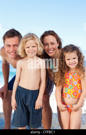 Happy family spending their time on the beach - Stock Photo