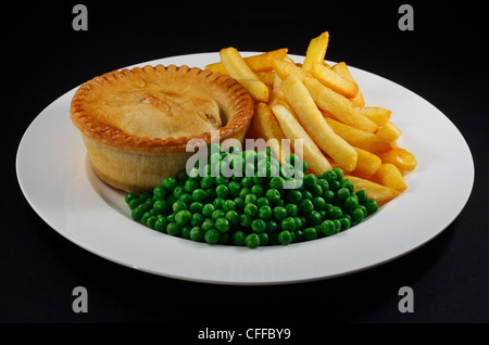 Pie and chips with peas. A traditional British Bar Dish - Stock Photo