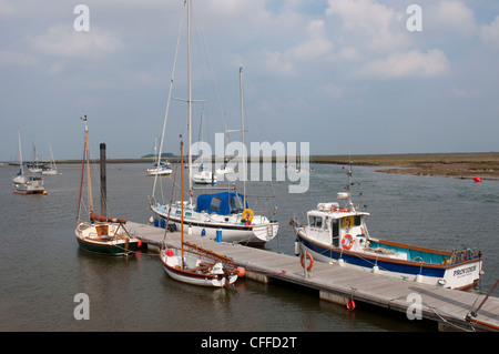 Boats moored in the harbour at Wells Next The Sea, Norfolk, East Anglia, England. - Stock Photo