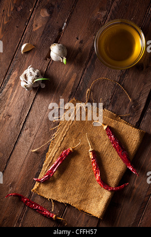 Dried Red Chili Peppers with Garlic and Olive Oil - Stock Photo