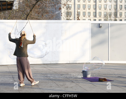 street performer creatng bubbles on South Bank, London, England, UK - Stock Photo