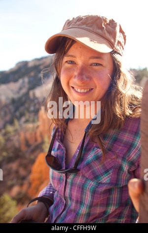 Young woman hiking in Bryce Canyon National Park. - Stock Photo