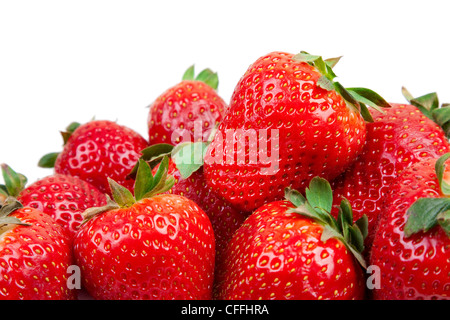 Close some strawberries against a white background. - Stock Photo