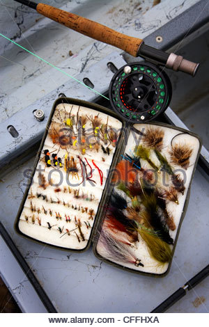A box of fly fishing lures while fly fishing on the Bow River in Calgary, Alberta, Canada. - Stock Photo