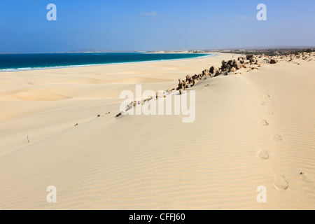 Praia de Chaves, Boa Vista, Cape Verde Islands. Volcanic rocks and sand dunes with footprints on white sandy beach - Stock Photo