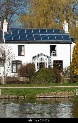 Solar panels on the roof of a house on the river Cam near Cambridge. England. - Stock Photo