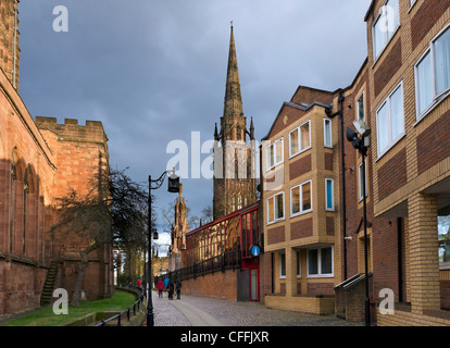 The spire of the old cathedral in the late afternoon with Holy Trinity Church to the left, Coventry, West Midlands, - Stock Photo
