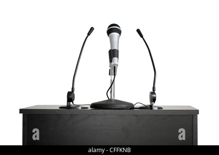 Podium with microphones, cut out on white background - Stock Photo