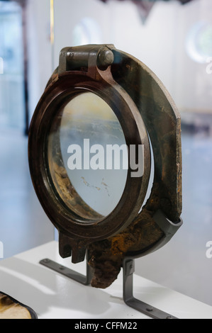 Porthole from 3rd class cabin of Titanic recovered from the wreck on the sea bed, on display at the Titanica Exhibition, - Stock Photo