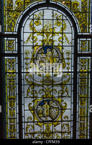 Stained Glass window taken from the Harland and Wolff drawing office on display at the Titanica Exhibition, Belfast - Stock Photo