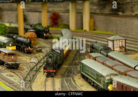 Model Railway Layout showing various trains and models - Stock Photo