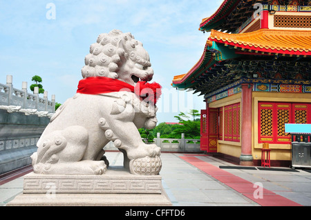 Chinese Lion Stone Sculpture in the Chinese Temple in Asia , Thailand - Stock Photo