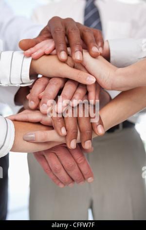 Hands put together for teamwork gesture - Stock Photo