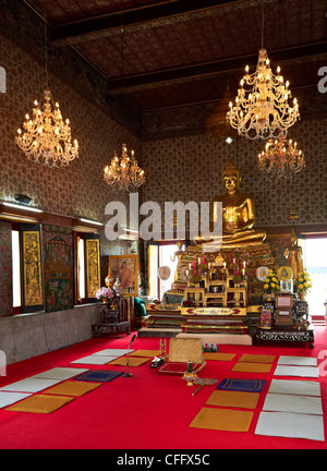 Golden sitting Buddha statue inside temple in Bangkok, Thailand - Stock Photo