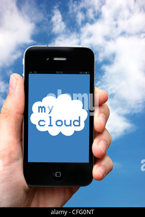 Symbol image, cloud computing. User sends data to an external server an gets access to his data from everywhere - Stock Photo