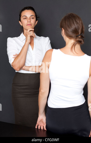 Mistrust between woman - Stock Photo