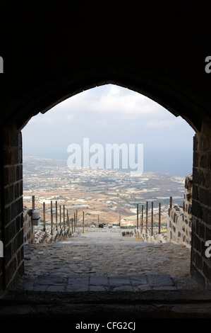 Qalaat Marqab. Syria. View of the coastal plain and Mediterranean through the arched entrance of the crusader castle. - Stock Photo